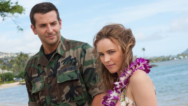 """This photo provided by Sony Pictures Entertainment shows Bradley Cooper, left, and Rachel McAdams in a scene from Columbia Pictures' """"Aloha."""" The movie releases in U.S. theaters on May 29, 2015. (Neal Preston/Sony Pictures Entertainment via AP)"""