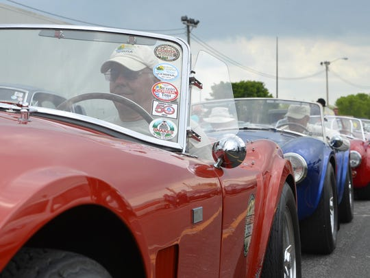 Shelby Cobra owners wait for the signal to drive their cars onto the S.S. Badger car ferry on Thursday. The group is on a tour around Lake Michigan.
