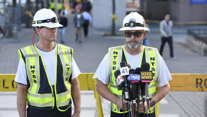 NTSB lead railroad investigator Jim Southworth, right, answers questions Tuesday with investigator Michael Hiller, left, during a news conference on Pier A in Hoboken. Federal investigators estimate a commuter train was traveling two to three times the 10 mph speed limit when it slammed into a New Jersey rail station last week, a U.S. official told The Associated Press on Tuesday.