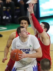 FGCU's Ricky Doyle rebounds against Liberty on Saturday