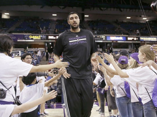 Sacramento Kings rookie center Sim Bhullar is greeted by fans as he runs onto the court to warm up before the Kings played the New Orleans Pelicans in an NBA basketball game in Sacramento, Calif., Friday, April 3,2015. (AP Photo/Rich Pedroncelli)