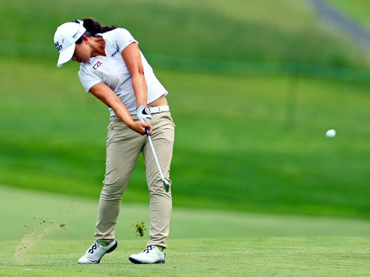 Sei Young Kim, of South Korea, hits from the fairway on the 11th hole during the second round of the KPMG Women's PGA championship at Westchester Country Club in Harrison, N.Y. Kim has a one-shot lead at the LPGA's second major of the season.