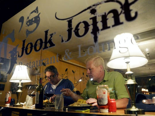 Andrew D'Agenais and Robert Godfrey, owners of upcoming wine bar The Handsome Cab, eat dinner at G's Jook Joint. G's Jook Joint, which opened in early September, has plenty of comfort food on the menu.
