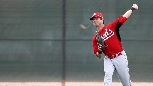 Non-roster invitee outfielder Jesse Winker throws to