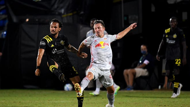 The Crew's Artur, left, fighting for the ball against the Red Bulls' Marc Rzatkowski, has embraced his role as the player tasked with chasing down opponents and winning possession of the ball.