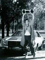 John Cusack strikes an iconic pose as Lloyd Dobler