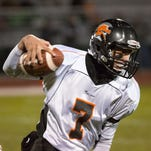York Suburban's Thomas Merkle runs for a first down during the team's District 3 first round game at Northern York on Nov. 13.  Northern York defeated York Suburban 30-16. The Trojans ended the season with an 8-3 overall record and were YAIAA Division II champions.