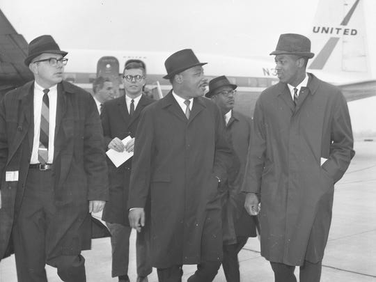 Dr. Martin Luther King Jr. arrives at the airport in