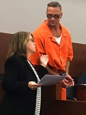 In this Aug. 17, 2017, file photo, Nevada death row inmate Scott Dozier confers with Lori Teicher, a federal public defender involved in his case, during an appearance in Clark County District Court in Las Vegas.