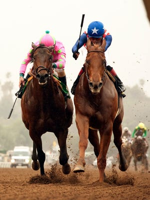Dortmund, right, and jockey Martin Garcia, hold off Firing Line and jockey Gary Stevens to win the Grade III $150,000 Robert B. Lewis Stakes horse race Feb. 7.