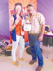 Jump with Jill star Laura Brown, MS, RD, with farmer Marty Wegner.