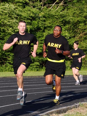 Sgt. Maj. of the Army Dan Dailey, left, conducts PT with soldiers at Redstone Arsenal, Ala., in May 2015. The Army's new fitness test for recruits could determine their career path.