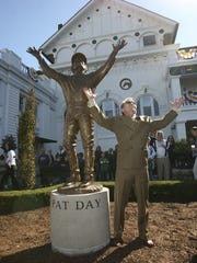 Pat Day replicates the famed gesture he made while thanking God for his 1992 Kentucky Derby victory.  The same pose is captured in sculptor Raymond Graf's life-sized bronze statue of Day, now on display at Churchill Downs.