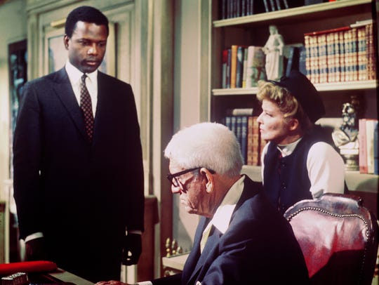 Sidney Poitier informs Spencer Tracy and Katharine