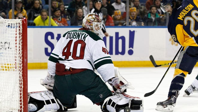 Minnesota Wild goalie Devan Dubnyk (40) makes a save on a shot by Buffalo Sabres left wing Matt Moulson (26) during the second period at First Niagara Center in Buffalo, N.Y., on Jan. 15.