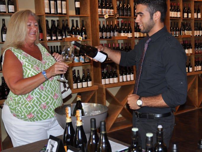 Melanie Campbell enjoys a glass of wine.