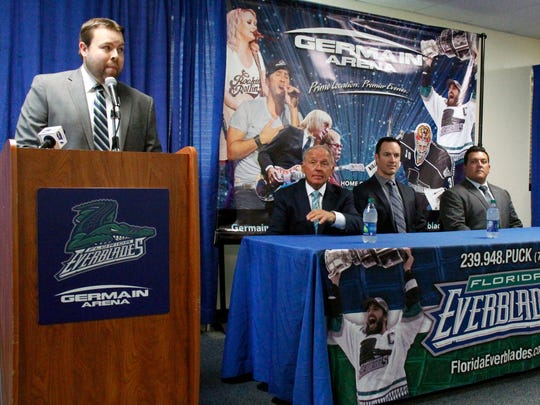 Media relations coordinator Alex Reed, left, introduced Brad Ralph, center, as the new head coach of the ECHL Florida Everblades as general manager Craig Brush and assistant Tad O'Had look on during a press conference at Germain Arena on Tuesday.