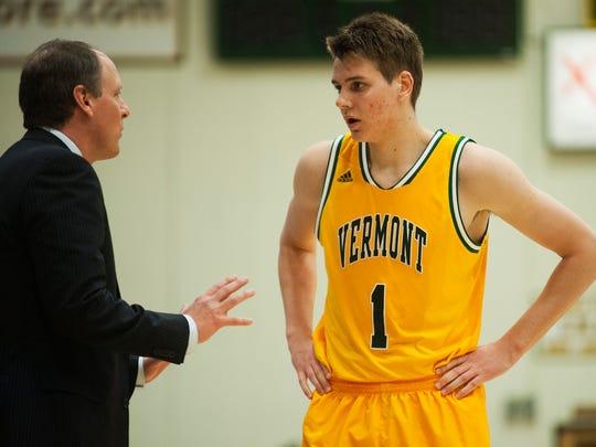 Vermont head coach John Becker talks to freshman forward Zach McRoberts (1) during a men's basketball game earlier this season.