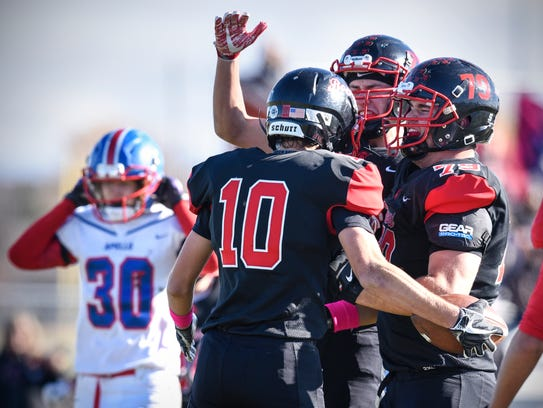 Rocori players celebrate a touchdown by Jesse Huber