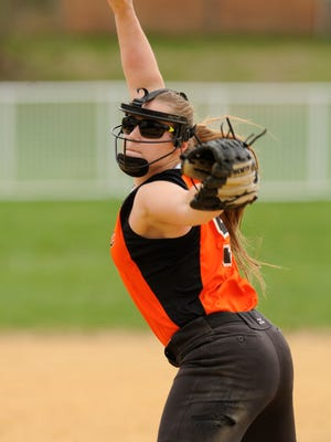 Dover High School's Mackenzie Taggart winds up a pitch during a game against Spackenkill last month.