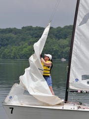 Sarah Russell brings down a sail during training at