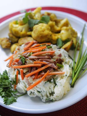 """The """"Not your mother's meat and potatoes"""" dishes, also shown below, are made up of Indian influences that include diced potatoes and chicken, and Danish influences that consists of mashed potatoes and bacon."""