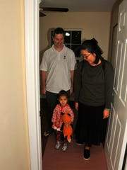 The Busch family takes a quick tour of the house, inspecting Natisha's room. Veteran Robert Busch, served in the Navy and the Army, was injured in Afghanistan and received the Purple Heart. On Friday night, Homes for Warriors presented Busch, his wife Yuri and three year old daughter Natisha with a house in Palm Bay.
