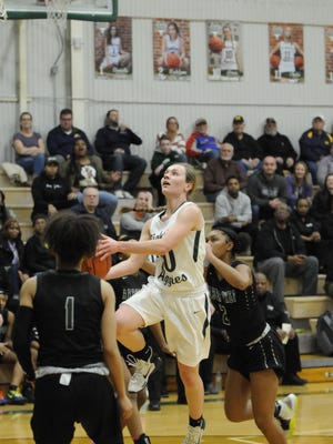 Sand Creek's Grace Francoeur goes up for a layup during a regional game against Arbor Prep in the 2019-20 season.