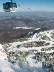 A skier works his way into the Face Chute at Jay Peak.