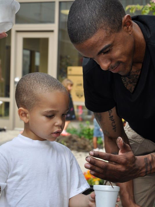 urban agriculture columbus father and son.jpg