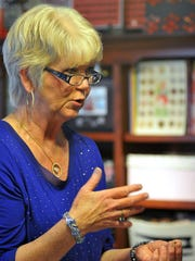 Robin Clevenger talks buttons at her home.