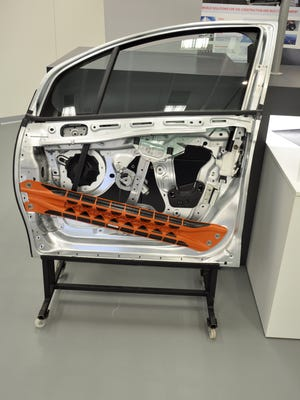 DuPont is collaborating with automakers on advanced composites that can replace metal in structural applications. This prototype side-intrusion beam replaces steel with DuPont Vizilon continuous woven glass fiber to reduce weight by 40 percent, while meeting requirements for structural and crash-protection parts.