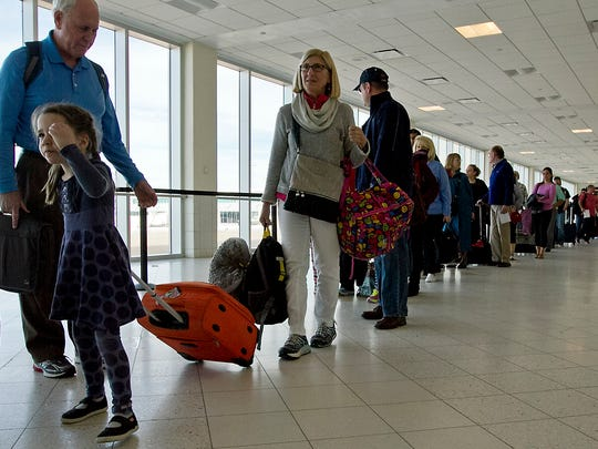 Passengers at Southwest Florida International Airport make their way towards the TSA checkpoint prior to their flight departure Tuesday (01/19/16) afternoon.