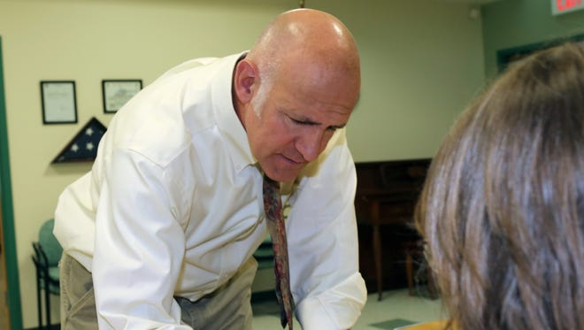 Putnam Valley Supervisor Robert Tendy signs in to vote at the town's senior center for the Republican primary. Tendy defeated Putnam County District Attorney Adam Levy in the primary, and again in Tuesday's general election.