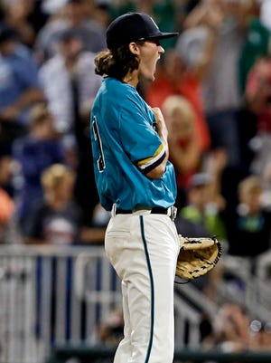 Coastal Carolina Chanticleers pitcher Bobby Holmes (31) reacts after the victory against the Arizona Wildcats in game two of the College World Series championship series at TD Ameritrade Park.