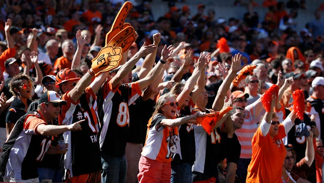 Bengals fans cheer during Sunday's game against the Titans.