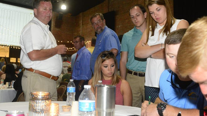 Republican Sheriff Todd Entrekin, standing at left, is surrounded by friends and family June 5, 2018, during an election watch party at the Pitman Theatre. Entrekin was defeated in the Republican primary for sheriff by then-Rainbow City Police Chief Jonathon Horton.