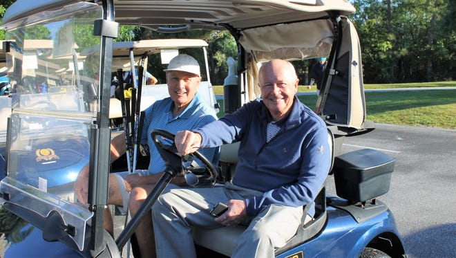 Henri Ball and Hope Center board President Jim Applegate head off to the shotgun start of last year's tournament.