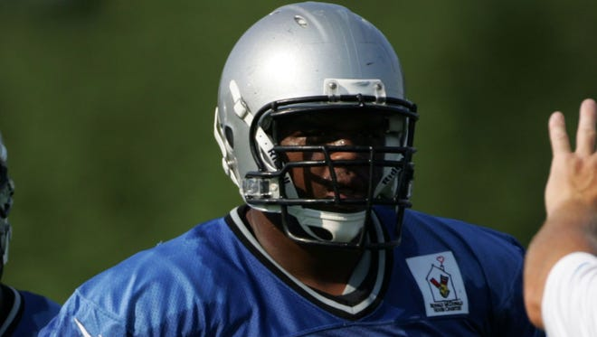 Detroit Lions tackle Corey Hilliard listens to coaches during training camp in Allen Park on Aug 3, 2012.
