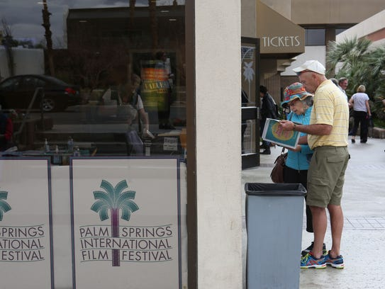 People look at the showtimes for the Palm Springs International