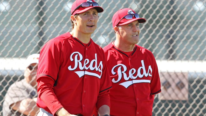 Reds manager Bryan Price (right) will start the season without Homer Bailey in the rotation.