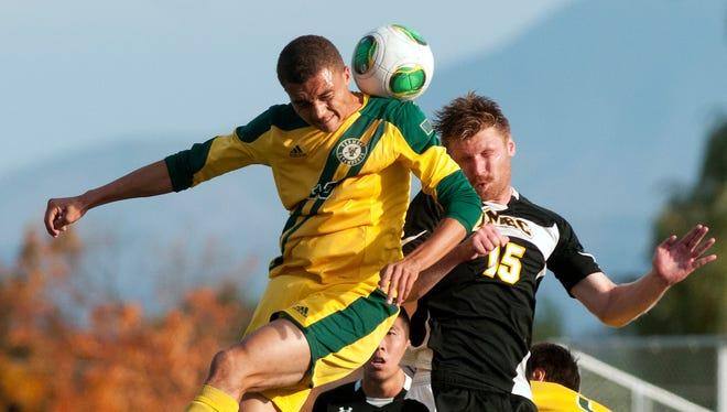 Vermont's Nile Walwyn (19) and UMBC's Zach Wenger (15) battle for a header during an America East men's' soccer game at Virtue Field last season.