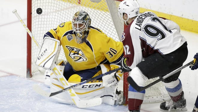 Predators goalie Carter Hutton, who came on after Pekka Rinne was pulled, blocks a shot as Avalanche left wing Gabriel Landeskog watches for the rebound in the second period.