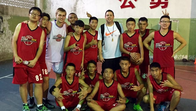 Ty Amundsen (standing, center) gained lifetime memories during his stay in China, coaching kids and helping coaches.