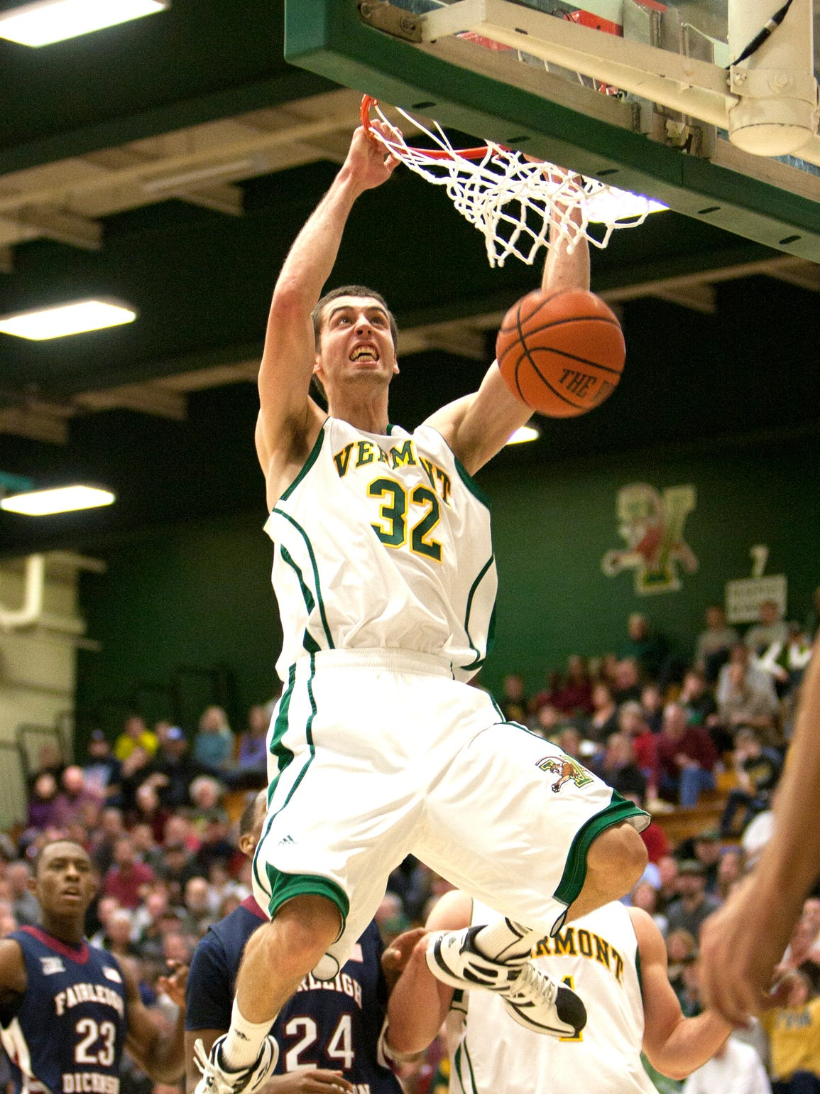 Ethan O'Day (center) of Vermont throws down a dunk