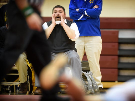 Northern Lebanon wrestling coach Rusty Wallace recorded his 100th career win Wednesday evening, Dec. 14, when the Vikings defeated Columbia 83-0. Wallace yells direction to his wrestlers during the lopsided win.