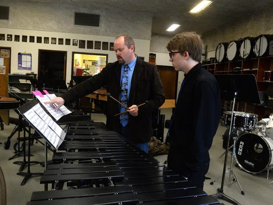 Clinician Troy Bashor gives feedback to Great Falls High's William Jardee during the MHSA District 6 Music Festival on Friday at CMR.