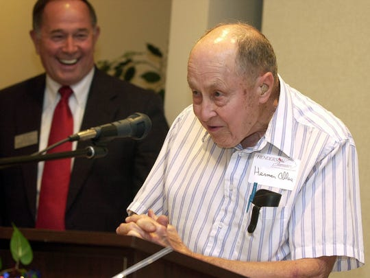 Henderson business man Herman Alles (right) makes a few comments after receiving the Henderson-Henderson Co. Chamber of Commerce 2002 Small Business Person of the Year award at a luncheon program Wednesday, August 28, 2002. (