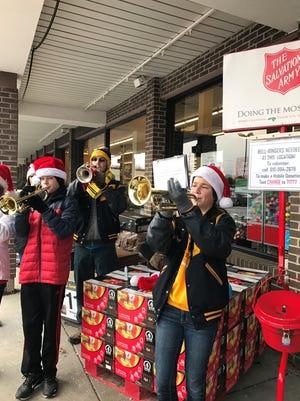 Students from Port Huron Northern and Port Huron high schools play Christmas carols Saturday.