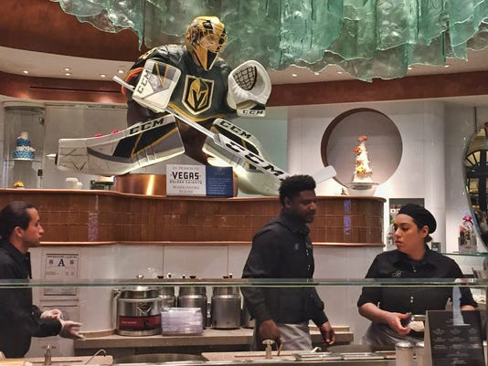 This Tuesday, April 10, 2018 photo, at the Bellagio casino-resort in Las Vegas shows a chocolate statue of Golden Knights goalie Marc-Andre Fleury. . The team is making its Stanley Cup playoff debut Wednesday, April 11, 2018, when they hosts the Los Angeles Kings. (AP Photo/Regina Garcia Cano)